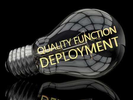 Quality Function Deployment - lightbulb on black background with text in it. 3d render illustration.