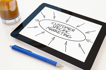 specific: Customer Specific Marketing - text concept on a mobile tablet computer on a desk - 3d render illustration.
