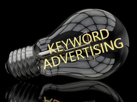 keyword: Keyword Advertising - lightbulb on black background with text in it. 3d render illustration.