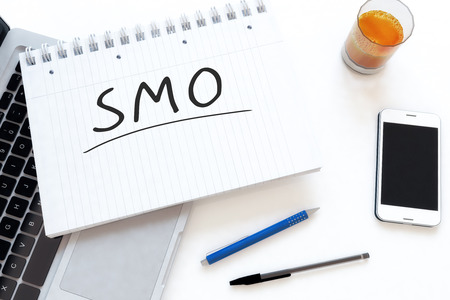 smo: SMO - Social Media Optimization - handwritten text in a notebook on a desk - 3d render illustration. Stock Photo