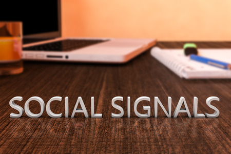 Social Signals letters on wooden desk with laptop computer and a notebook. 3d render illustration.