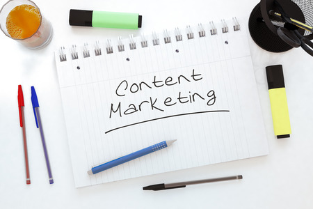 keywords link: Content Marketing handwritten text in a notebook on a desk - 3d render illustration. Stock Photo