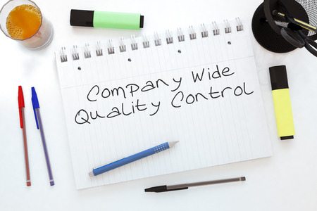 structuring: Company Wide Quality Control handwritten text in a notebook on a desk - 3d render illustration. Stock Photo