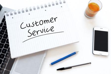 service desk: Customer Service handwritten text in a notebook on a desk - 3d render illustration.