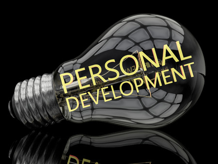 Personal Development - lightbulb on black background with text in it. 3d render illustration.