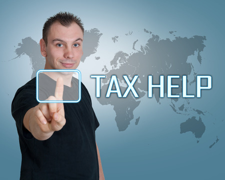 help button: Young man press digital Tax Help button on interface in front of him Stock Photo