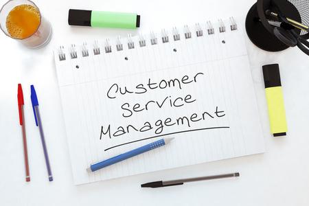 service desk: Customer Service Management - handwritten text in a notebook on a desk - 3d render illustration.