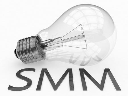 smm: SMM - Social Media Marketing - lightbulb on white background with text under it. 3d render illustration.