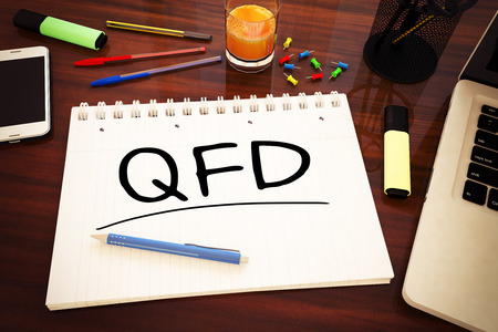 training and development: QFD - Quality Function Deployment - handwritten text in a notebook on a desk - 3d render illustration.