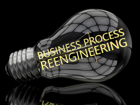 redesign: Business Process Reengineering - lightbulb on black background with text in it. 3d render illustration. Stock Photo