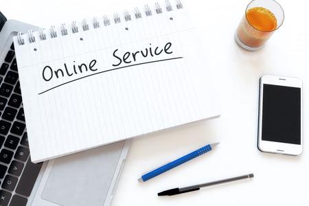 service desk: Online Service - handwritten text in a notebook on a desk - 3d render illustration.