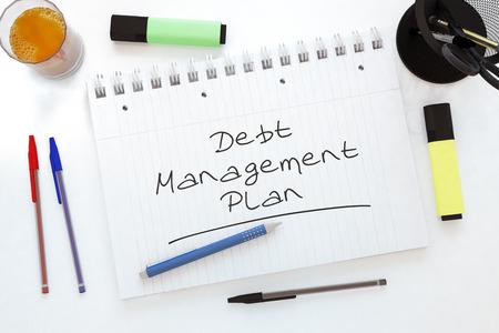 debt management: Debt Management Plan - handwritten text in a notebook on a desk - 3d render illustration.