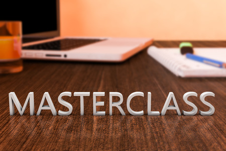 elearn: Masterclass - letters on wooden desk with laptop computer and a notebook. 3d render illustration.