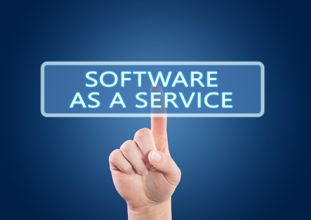 as: Software as a Service - hand pressing button on interface with blue background.