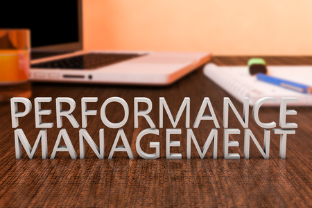 business performance: Performance Management - letters on wooden desk with laptop computer and a notebook. 3d render illustration.