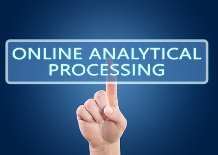online analytical processing: Online Analytical Processing - hand pressing button on interface with blue background. Stock Photo