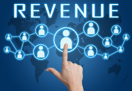 business goal: Revenue concept with hand pressing social icons on blue world map background. Stock Photo