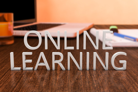 elearning: Online Learning - letters on wooden desk with laptop computer and a notebook. 3d render illustration.