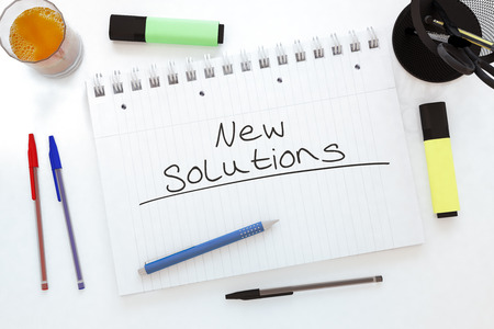 new solutions: New Solutions - handwritten text in a notebook on a desk - 3d render illustration.