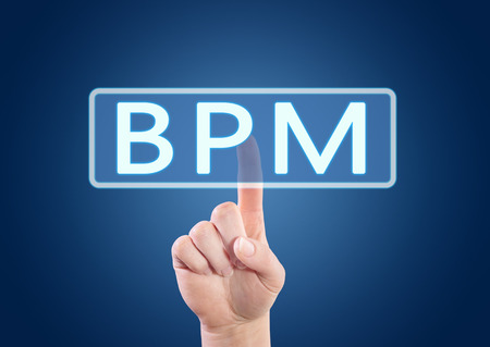 bpm: BPM - Business Process Management - hand pressing button on interface with blue background. Stock Photo
