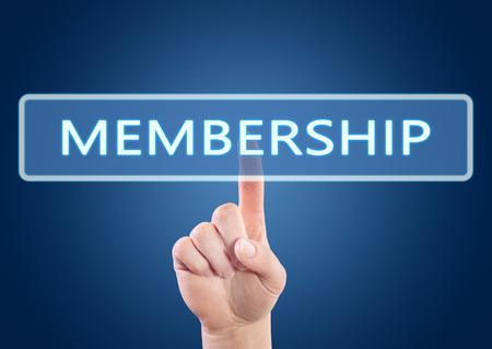 Membership - hand pressing button on interface with blue background.