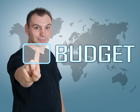 current account: Young man press digital Budget button on interface in front of him