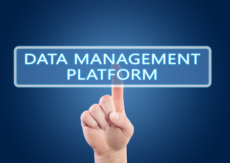 unify: Data Management Platform - hand pressing button on interface with blue background. Stock Photo
