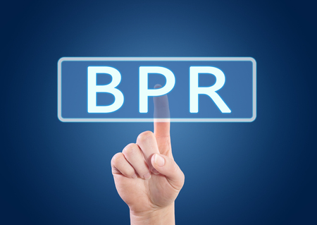 business process reengineering: BPR - Business Process Reengineering - hand pressing button on interface with blue background.