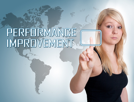 performance improvement: Young woman press digital Performance Improvement button on interface in front of her Stock Photo