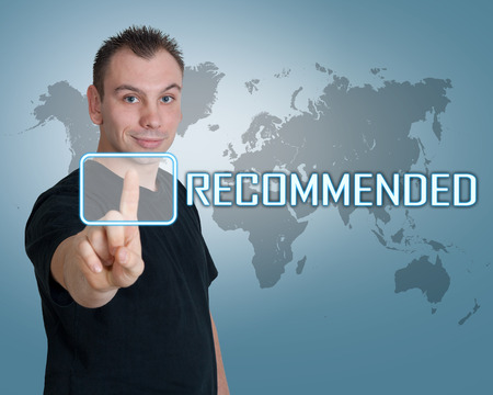 product reviews: Young man press digital Recommended button on interface in front of him