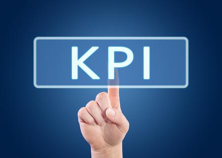 kpi: KPI - Key Performance Indicator - hand pressing button on interface with blue background. Stock Photo