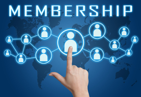 Membership concept with hand pressing social icons on blue world map background. Banque d'images
