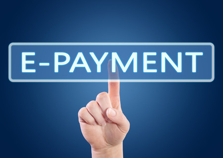 epayment: E-Payment - hand pressing button on interface with blue background. Stock Photo