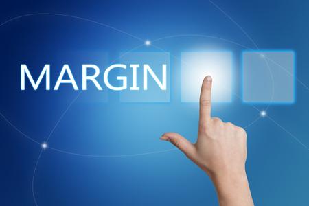margen: Margen - presionando el bot�n en la interfaz con el fondo azul mano. Foto de archivo