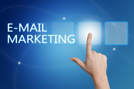 email: E-Mail Marketing - hand pressing button on interface with blue background. Stock Photo
