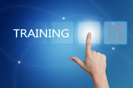 knowlage: Training - hand pressing button on interface with blue background. Stock Photo