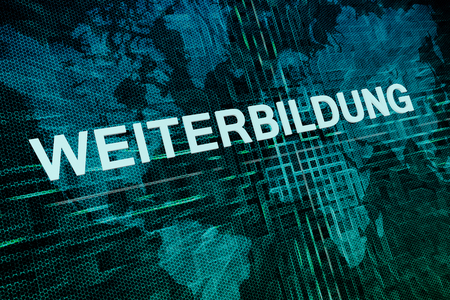 Weiterbildung - german word for further education text concept on green digital world map background Stock Photo