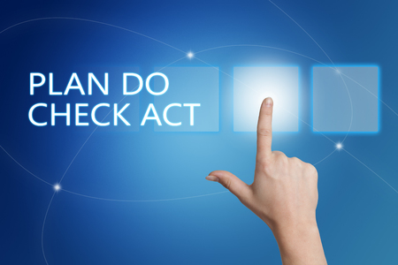 plan do check act: Plan Do Check Act - hand pressing button on interface with blue background.
