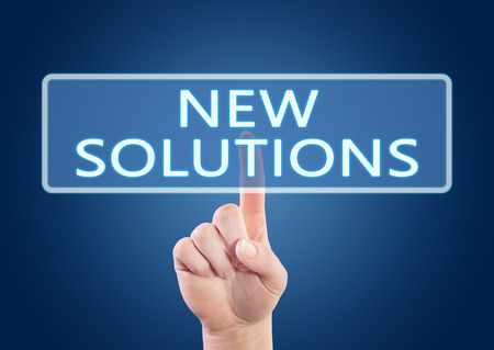 new solutions: New Solutions - hand pressing button on interface with blue background.