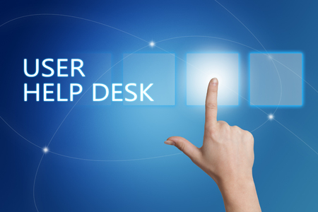 customer support: User Help Desk - hand pressing button on interface with blue background. Stock Photo