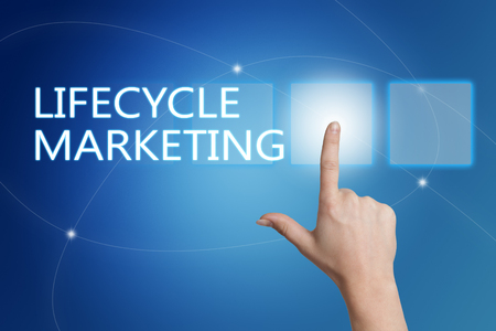 lifecycle: Lifecycle Marketing - hand pressing button on interface with blue background.