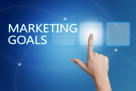 marketing goals: Marketing Goals - hand pressing button on interface with blue background. Stock Photo