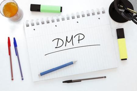 debt management: DMP - Data Management Platform or Debt Management Plan - handwritten text in a notebook on a desk - 3d render illustration.