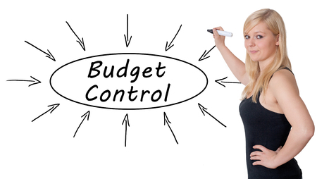 budgets: Budget Control - young businesswoman drawing information concept on whiteboard. Stock Photo