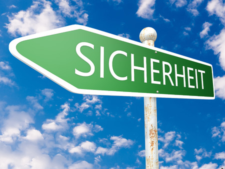 sicherheit: Sicherheit -german word for safety or security - street sign illustration in front of blue sky with clouds. Stock Photo