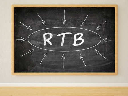 stock ticker board: RTB - Real Time Bidding - 3d render illustration of text on black chalkboard in a room.