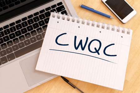 structuring: CWQC - Company Wide Quality Control - handwritten text in a notebook on a desk - 3d render illustration.