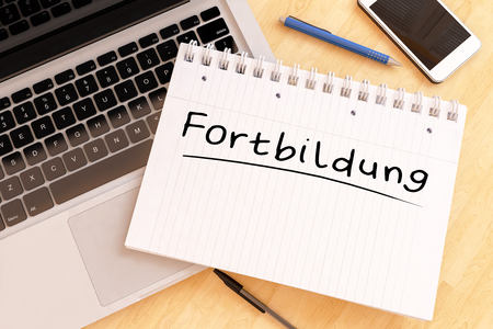 Fortbildung - german word for further education - handwritten text in a notebook on a desk - 3d render illustration.