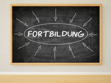 further education: Fortbildung - german word for further education - 3d render illustration of text on black chalkboard in a room. Stock Photo
