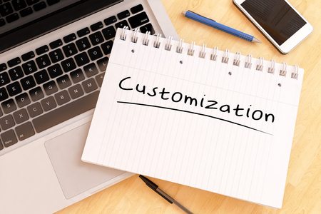 customization: Customization - handwritten text in a notebook on a desk - 3d render illustration.